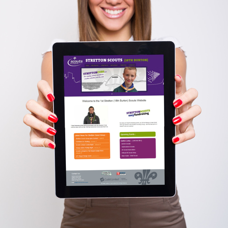 Woman holding a Tablet Computer Showing a Cuskit Designed Website